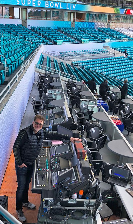 Alex Guessard behind one of the front-of-house desks in the Hard Rock Stadium