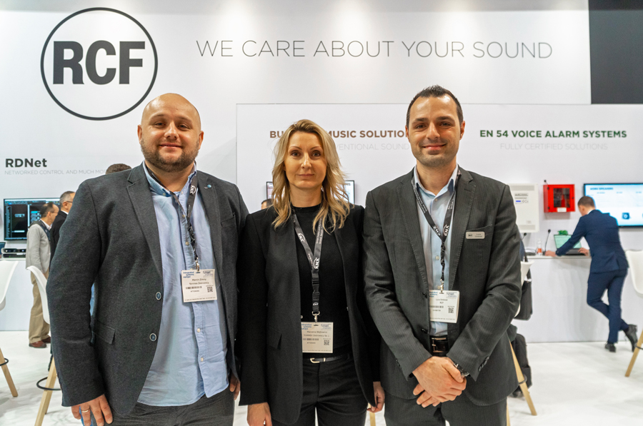 Marcin Zimny, Marzena Wójtowicz and Luca Ombrati with behind the RCF stand.